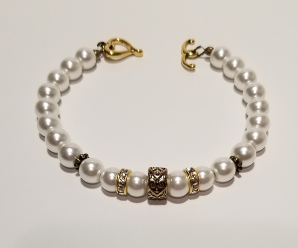 Elegant white bracelet with Swarovski crystal accents. Bead size approx. 6mm