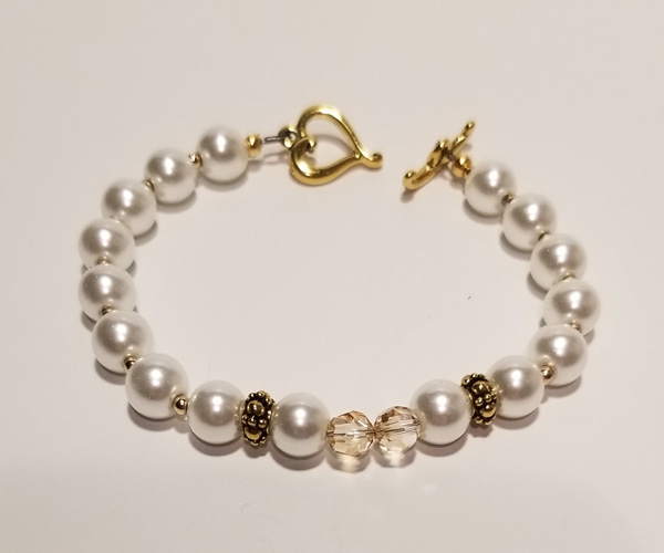 Very pretty white bracelet with Swarovski crystal accents.
