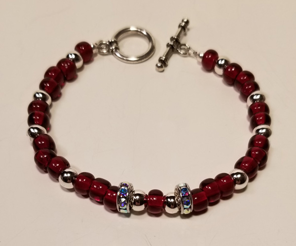 Delicate red and silver bracelet.  Bead size approx. 4mm