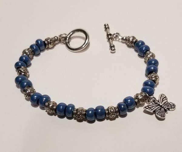 Butterfly Charm.  Slate blue bracelet. Bead size approx 4mm