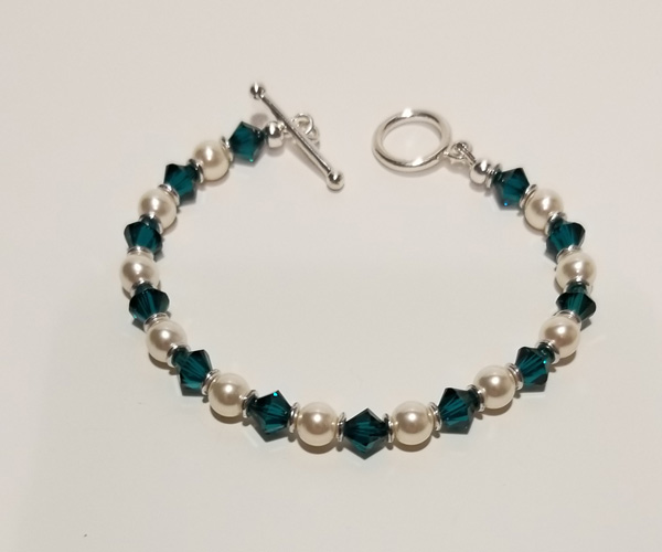 Swarovski emerald crystals and pearls. Bead size approx 4mm