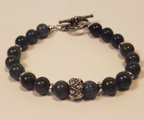 Marbled blue with suttle silver accents. Bead Size Approx 6m