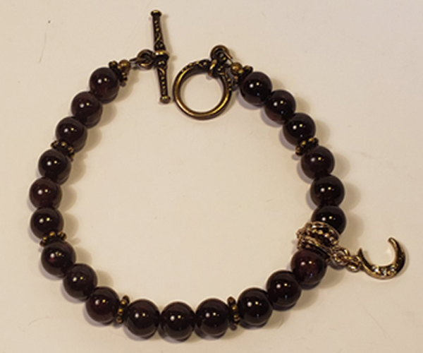 Deep Burgundy beads accented with lovely moon charm.