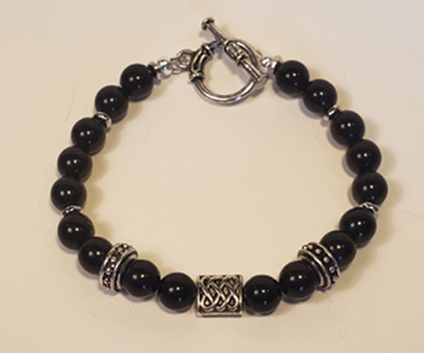 Black beads accented with Silver baubles. Bead size approx 6mm