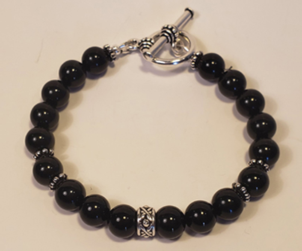 Accented with silver, this black beaded bracelet is suttle and elegant. Bead size approx 6mm