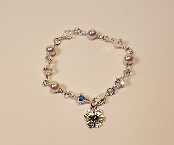 Delicate pearls and crystal bracelet with a flower toggle. Bead size approx 6mm
