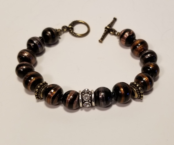 Tigers eye like beads with accents.  Bead size - approx 8 mm